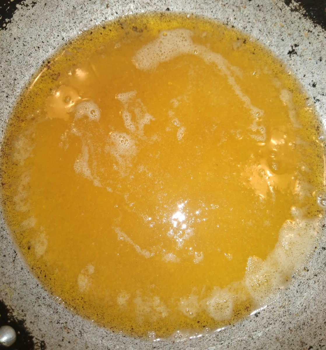 Add 3/4 cup of ghee to a pan and heat it over medium flame for 2-3 minutes.