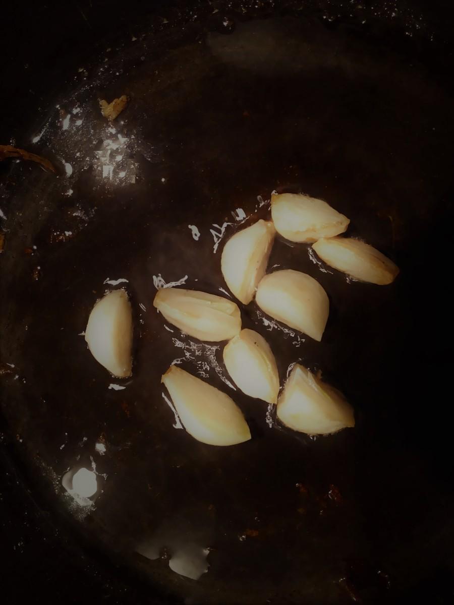 Whole garlic cloves in saute pan