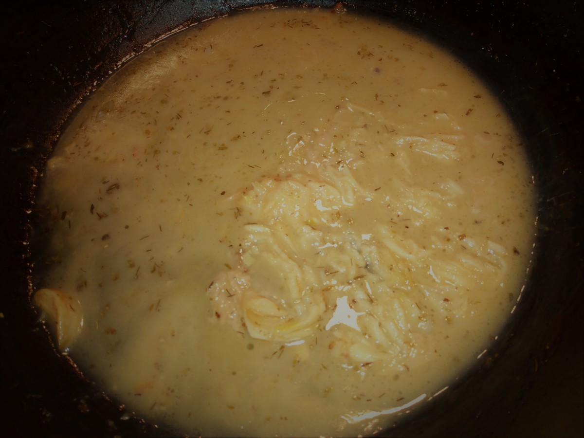 After the chicken and potatoes are roasted, the whole cloves of garlic are soft and creamy. Mash them into the pan juices to create a rich sauce.