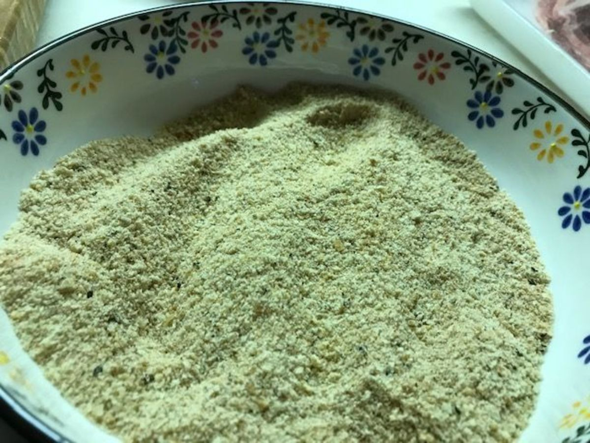 Mix the breadcrumbs with spices, mix, and set aside.