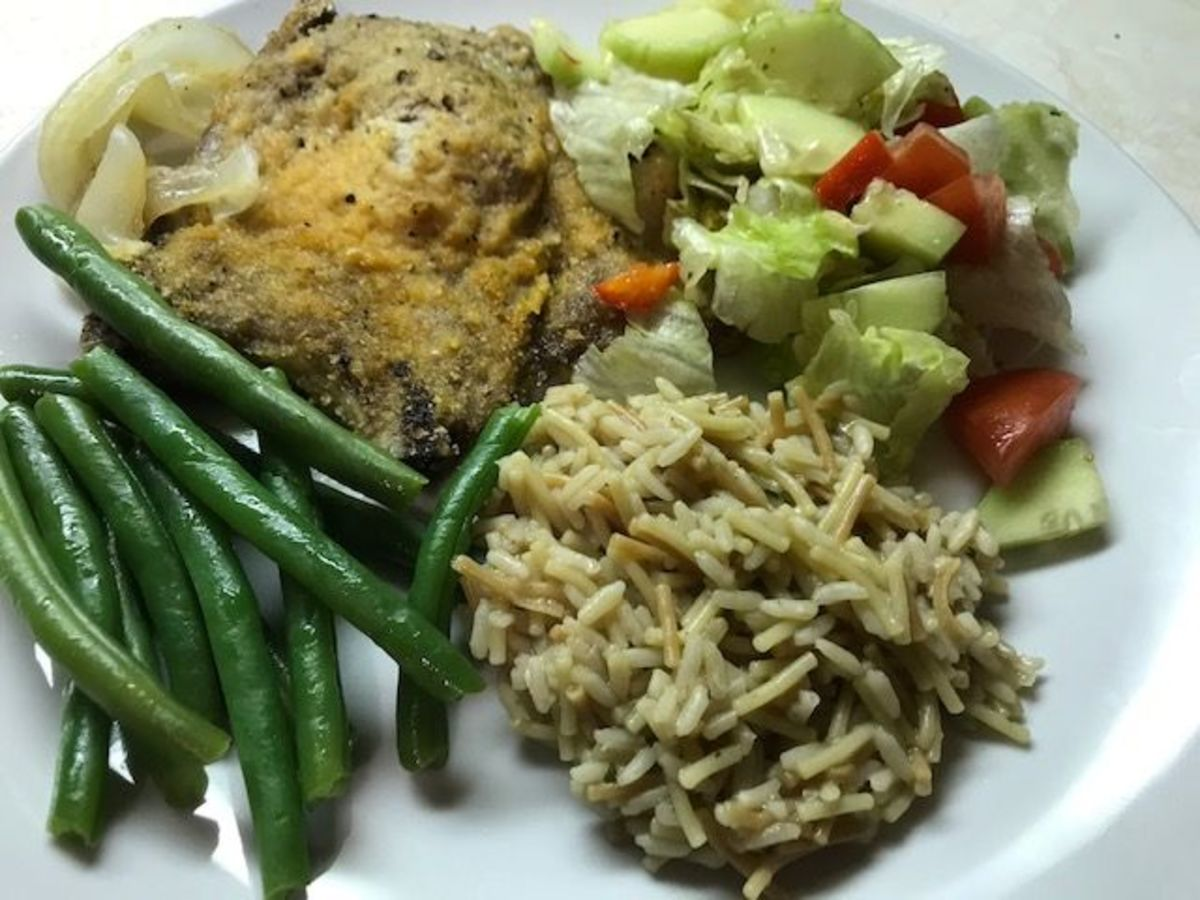 Garlicky pork chops served with green beans, rice, and a garden salad.