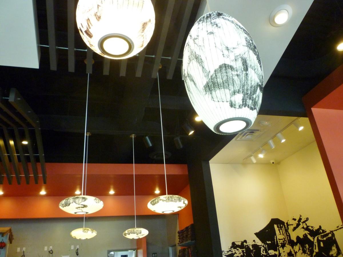 Paper-shaded lighting fixtures