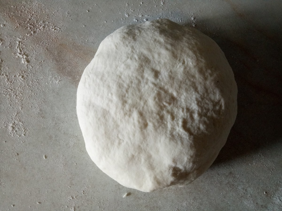 Knead until the dough forms a ball.