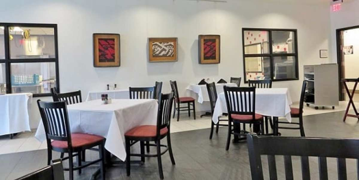 Interior of Courses Restaurant, located at the Art Institute of Houston