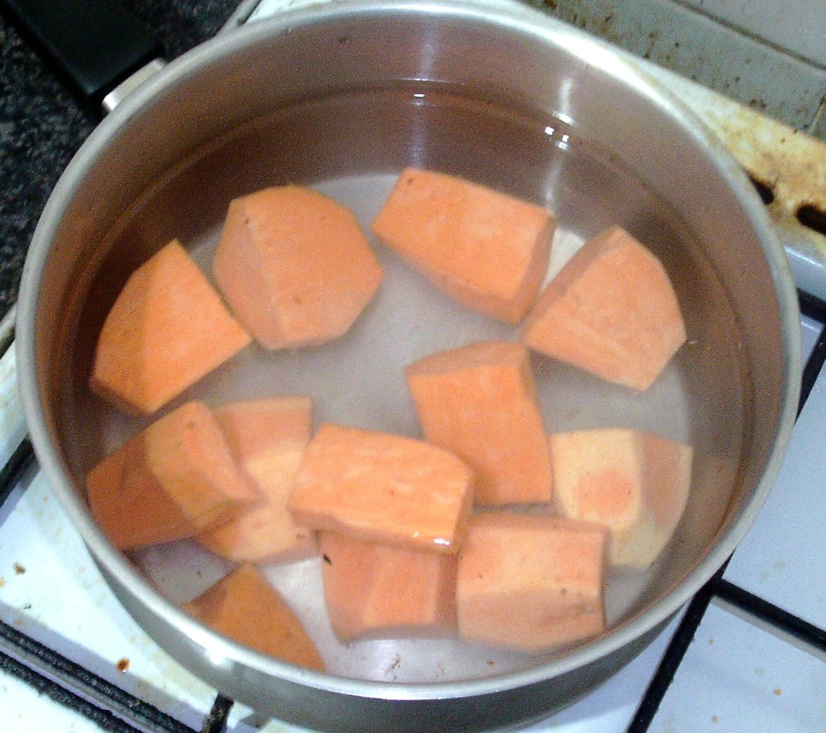 Chopped sweet potatoes ready for boiling