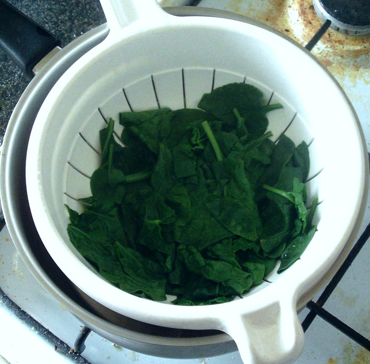 Drained spinach is left to cool