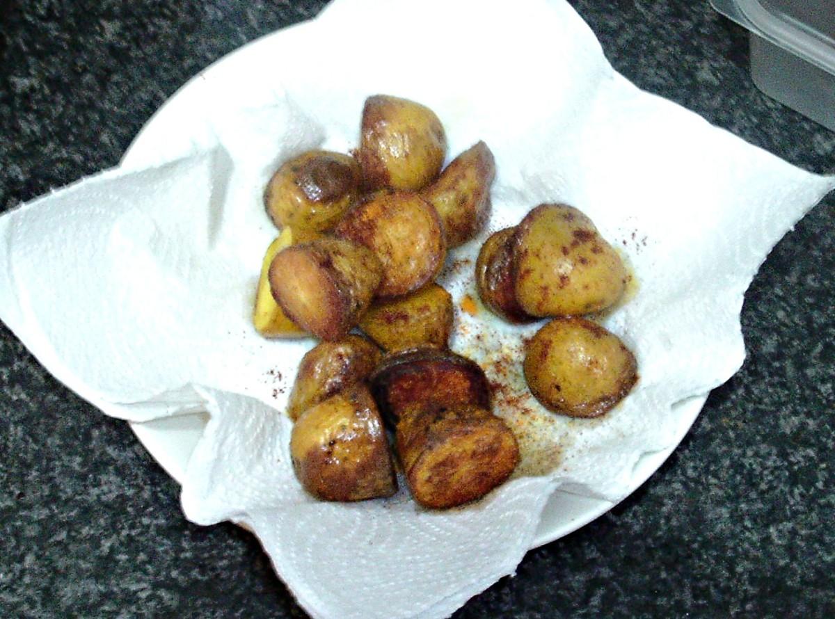 Roast potatoes are drained and seasoned