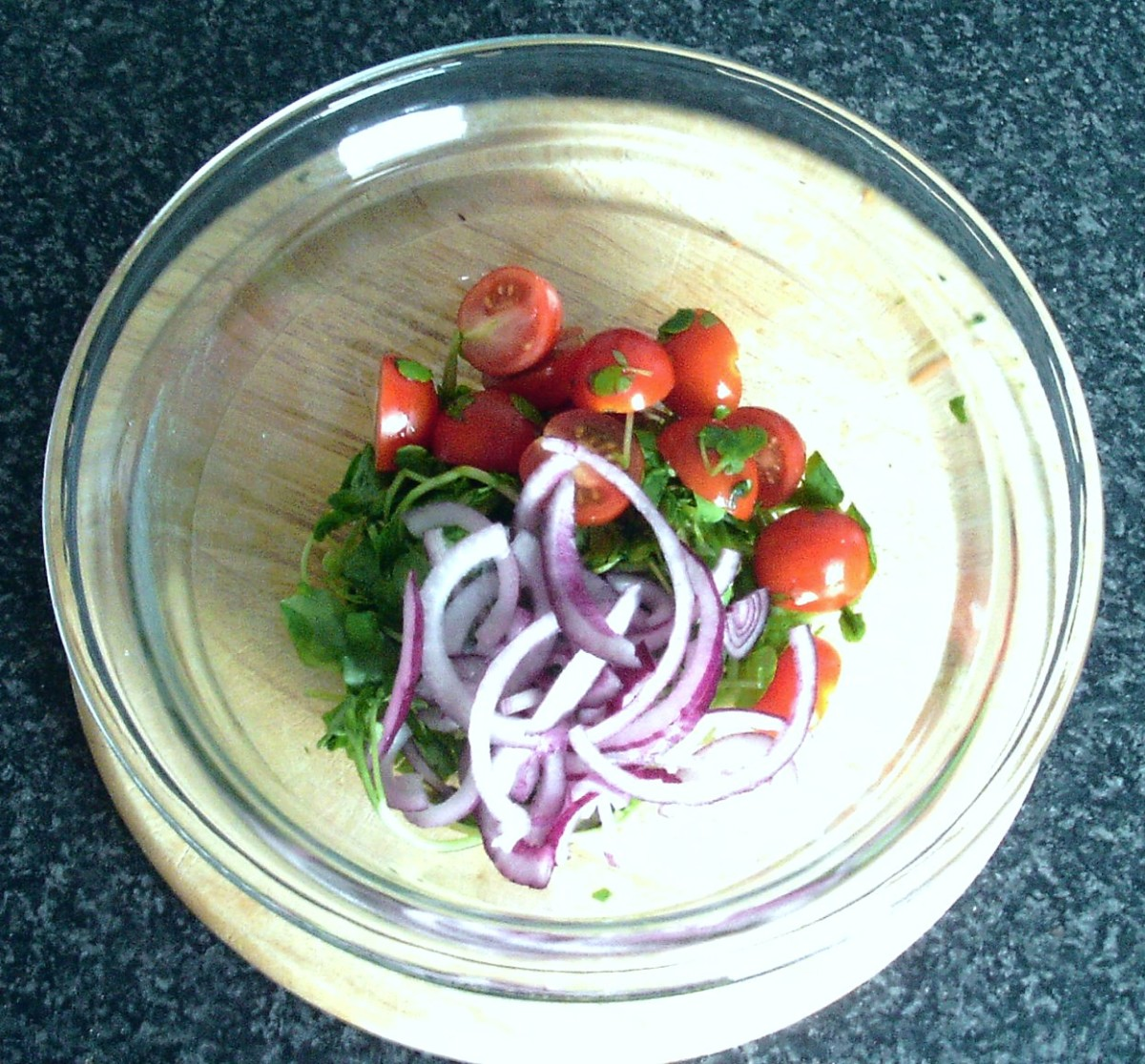 Salad ingredients are combined in a small bowl