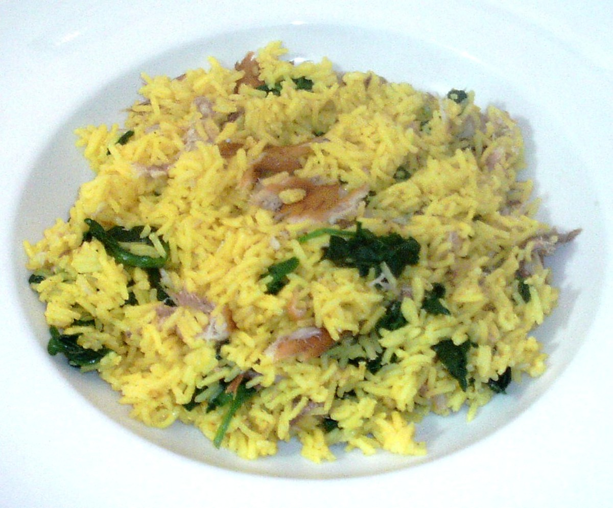 Turmeric rice is infused with baby spinach leaves and smoked mackerel flakes