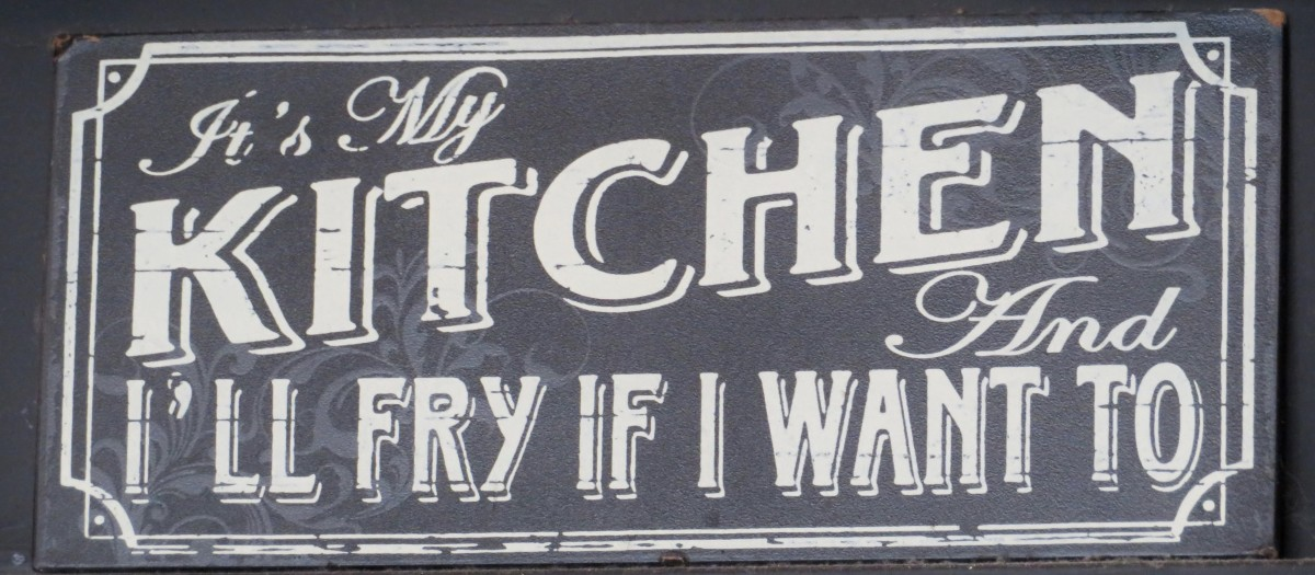 This sign is hanging inside, by the kitchen