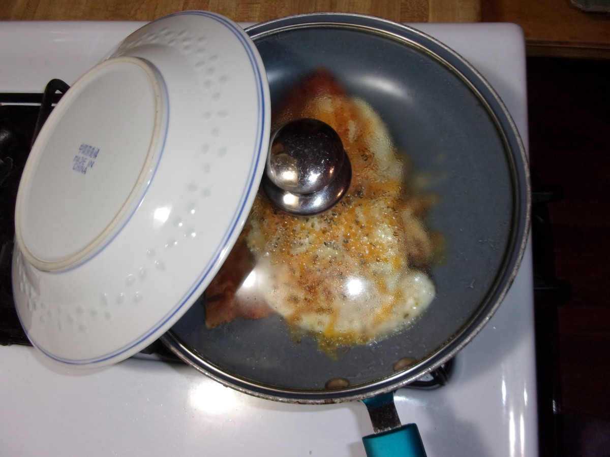 I like to prop my plate against the skillet to warm it. Use a pot holder to lift it. It may be quite hot!