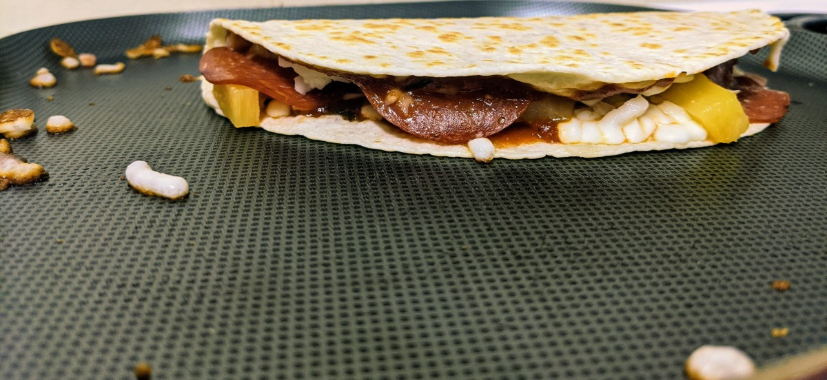 The desired crispiness of the outside of a pizzadilla is a personal preference. I prefer a little crunch but not so much that the tortilla cracks when folded.