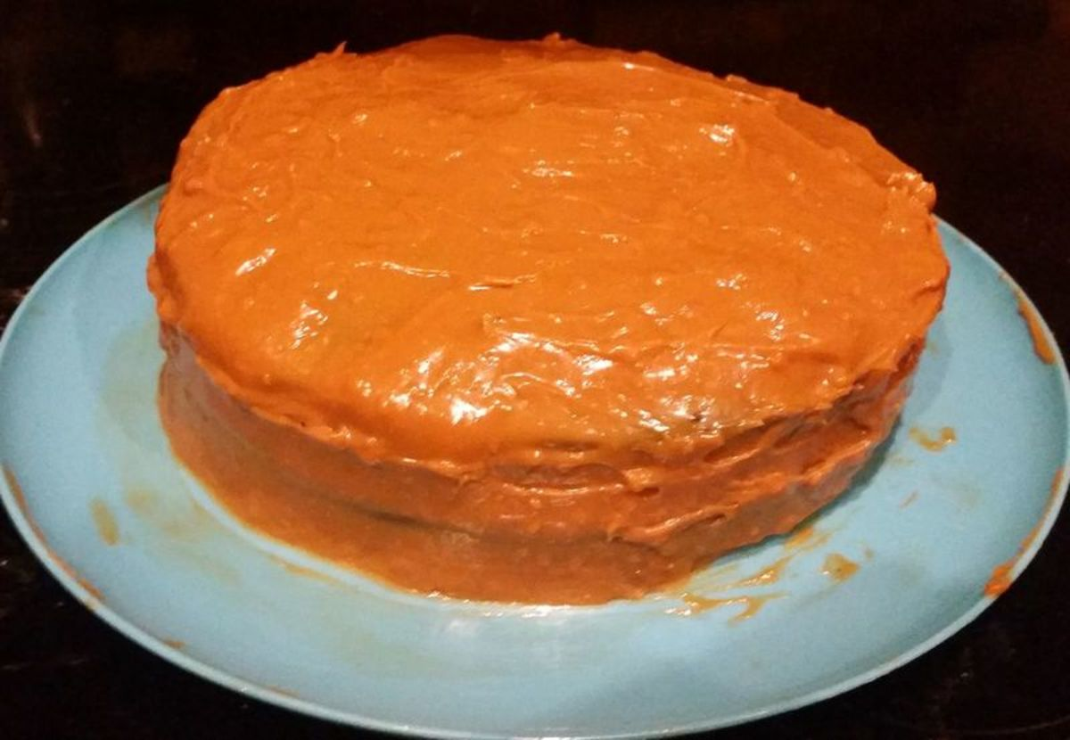 Two-layer chocolate cake with caramelized dulce de leche filling and topping