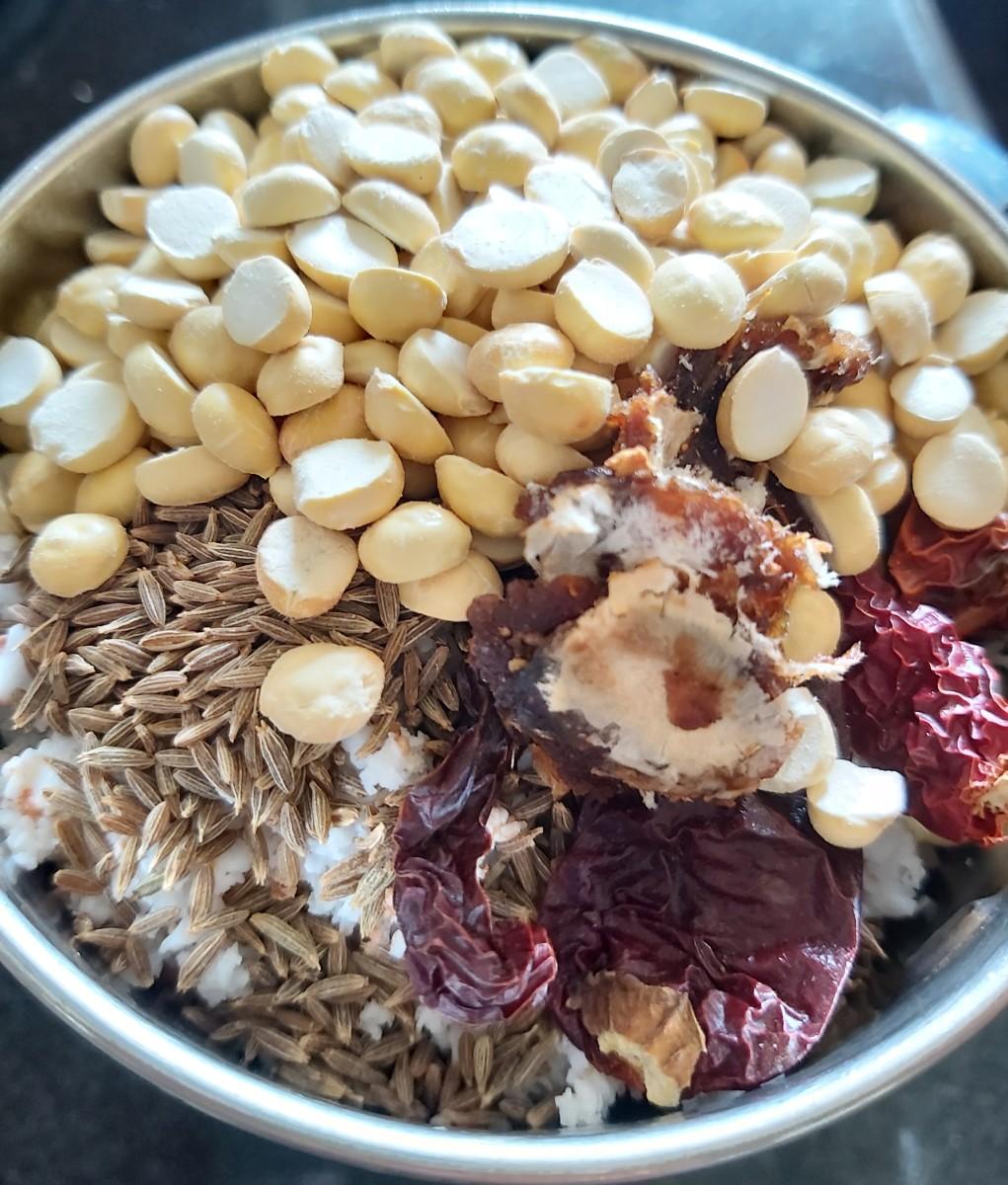 Add 2 teaspoons of cumin seeds, 1 teaspoon of tamarind pulp, 2-3 tablespoons of fried gram and 4-5 byadagi (Kashmiri red chilies).
