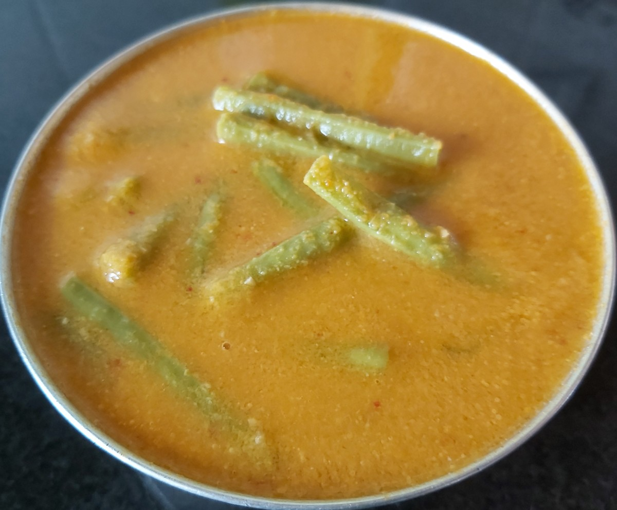 Tasty Mangalore-style sambar with long beans is ready to serve.