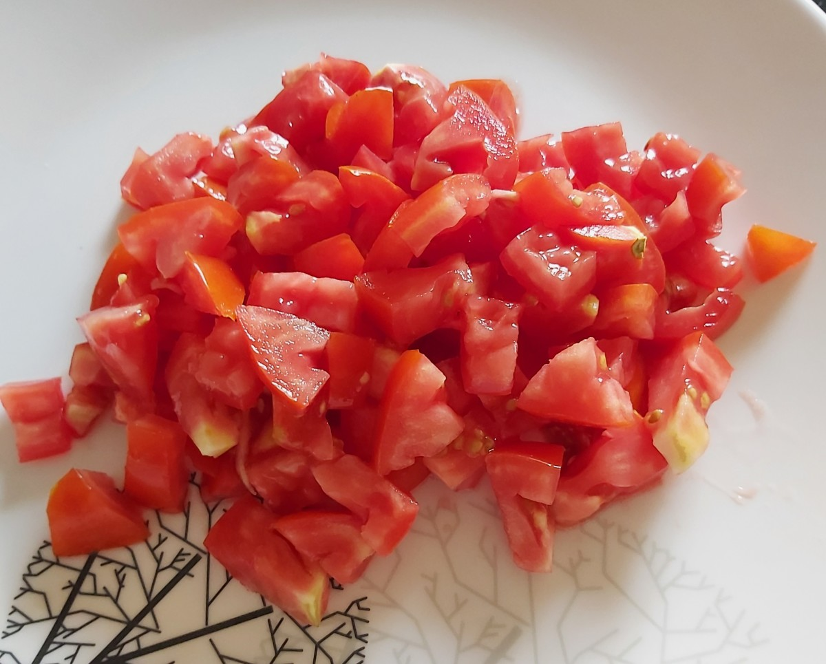 Wash and chop ripe tomatoes and set aside. Chop any other vegetables you might be using, as well.