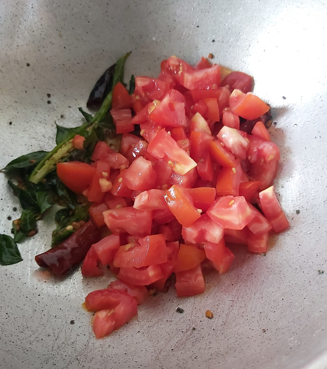 Add the chopped tomatoes (and any other vegetables you may be adding).