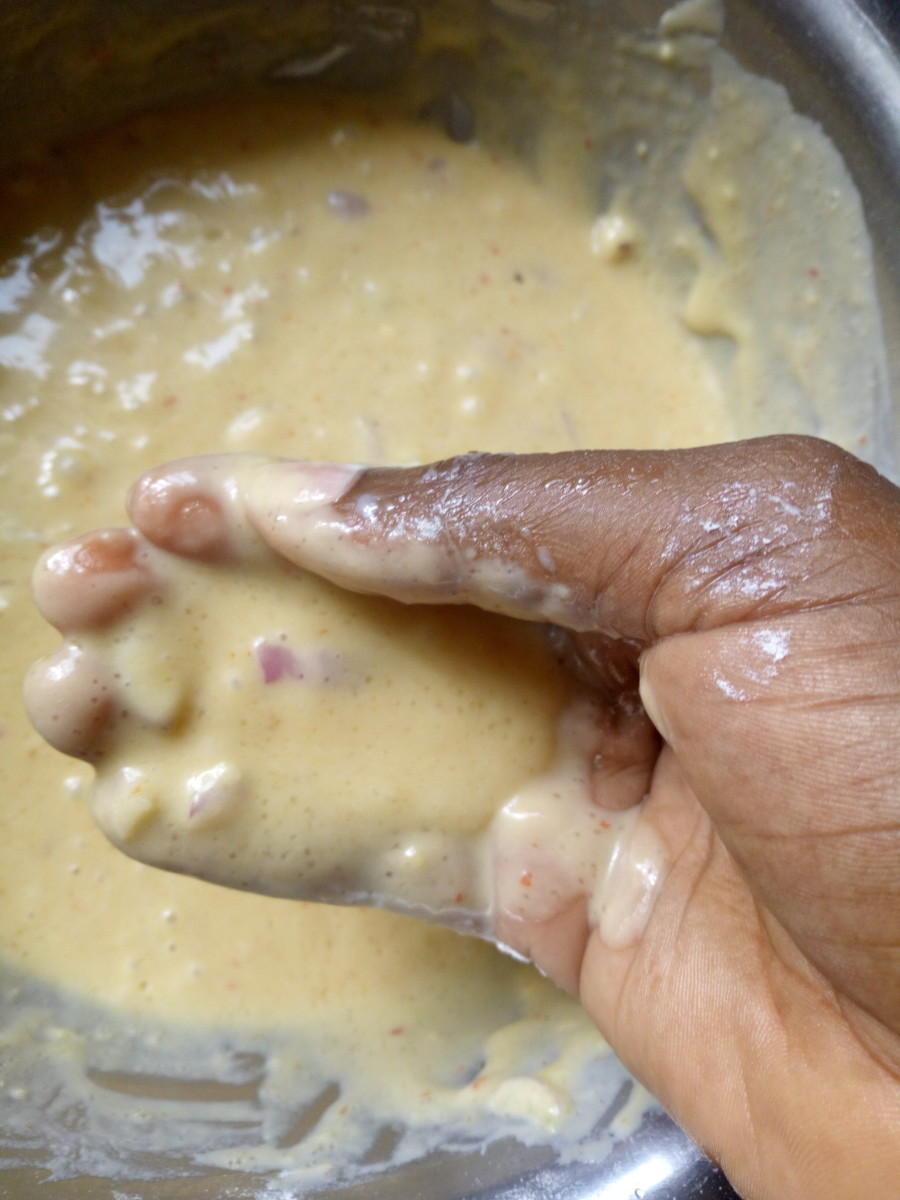 Cut portions of the batter with your hand, and drop them into the deep-fryer.