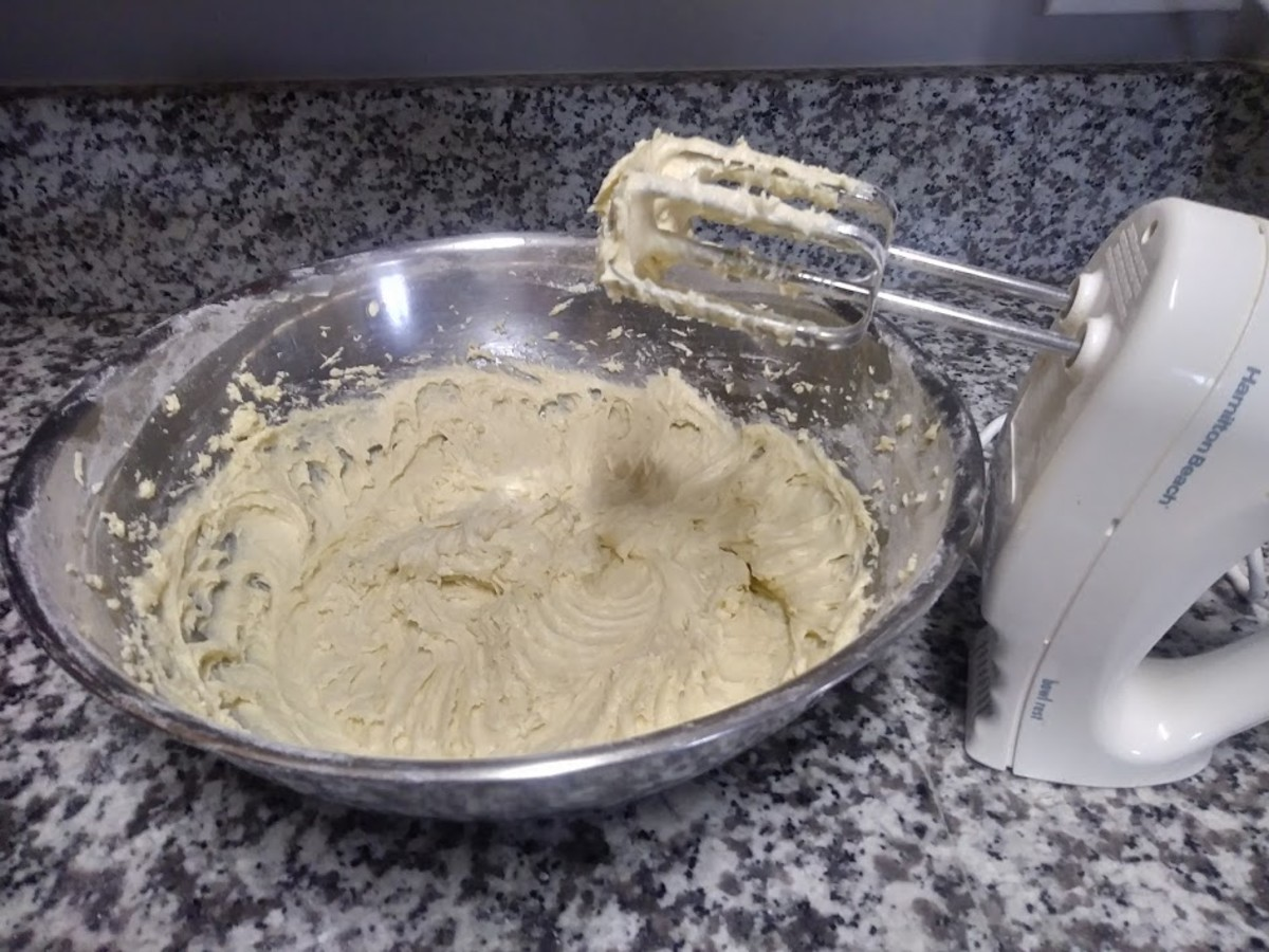 Add half the dry mixture to the sugar mixture, add the yogurt, and then add the rest of the dry mixture. Add the vanilla last.