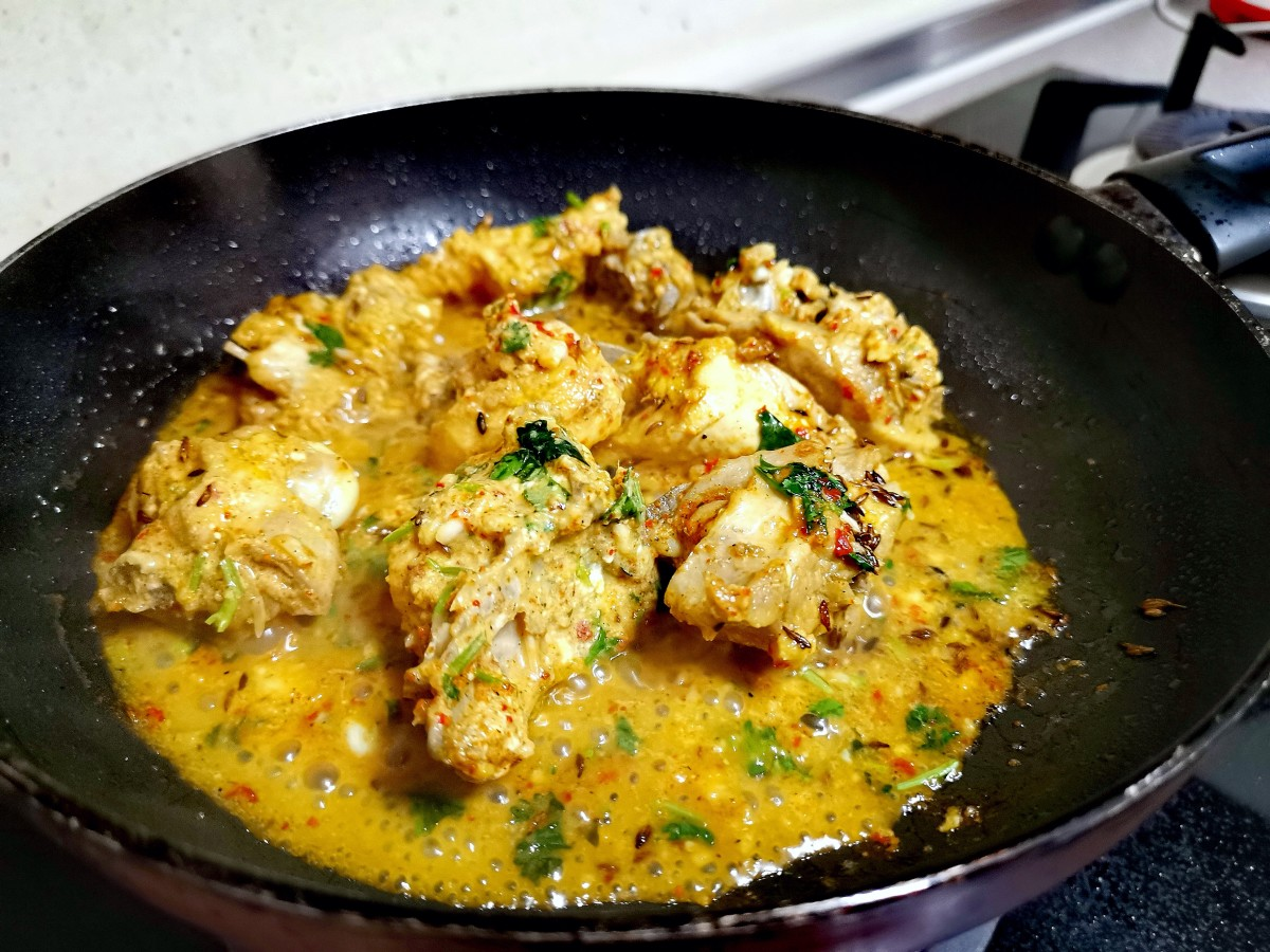 In a pan, add butter. When it starts melting, add the marinated chicken and stir well.