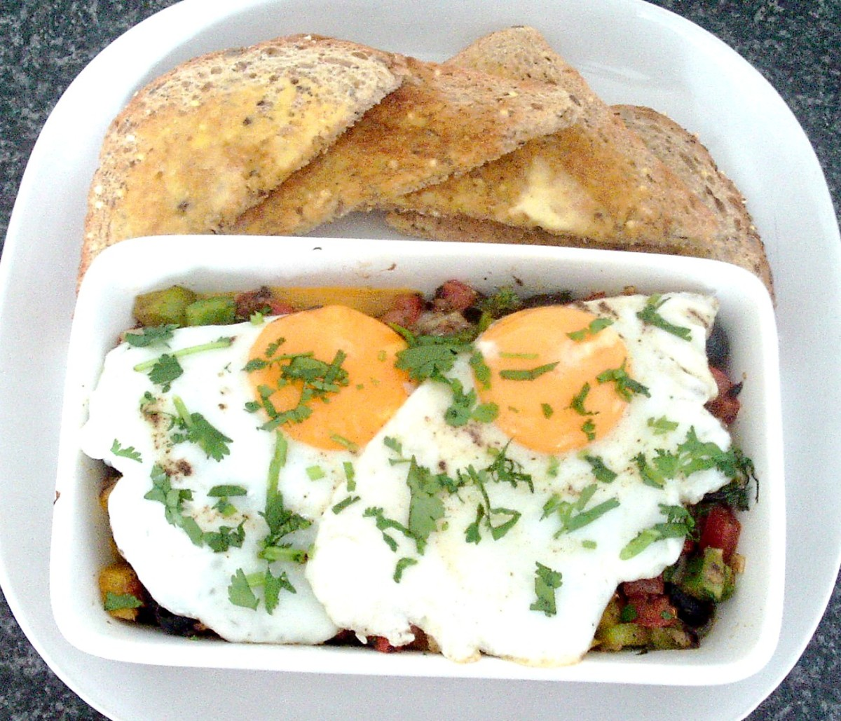 Hot and spicy fisherman's eggs served with toast