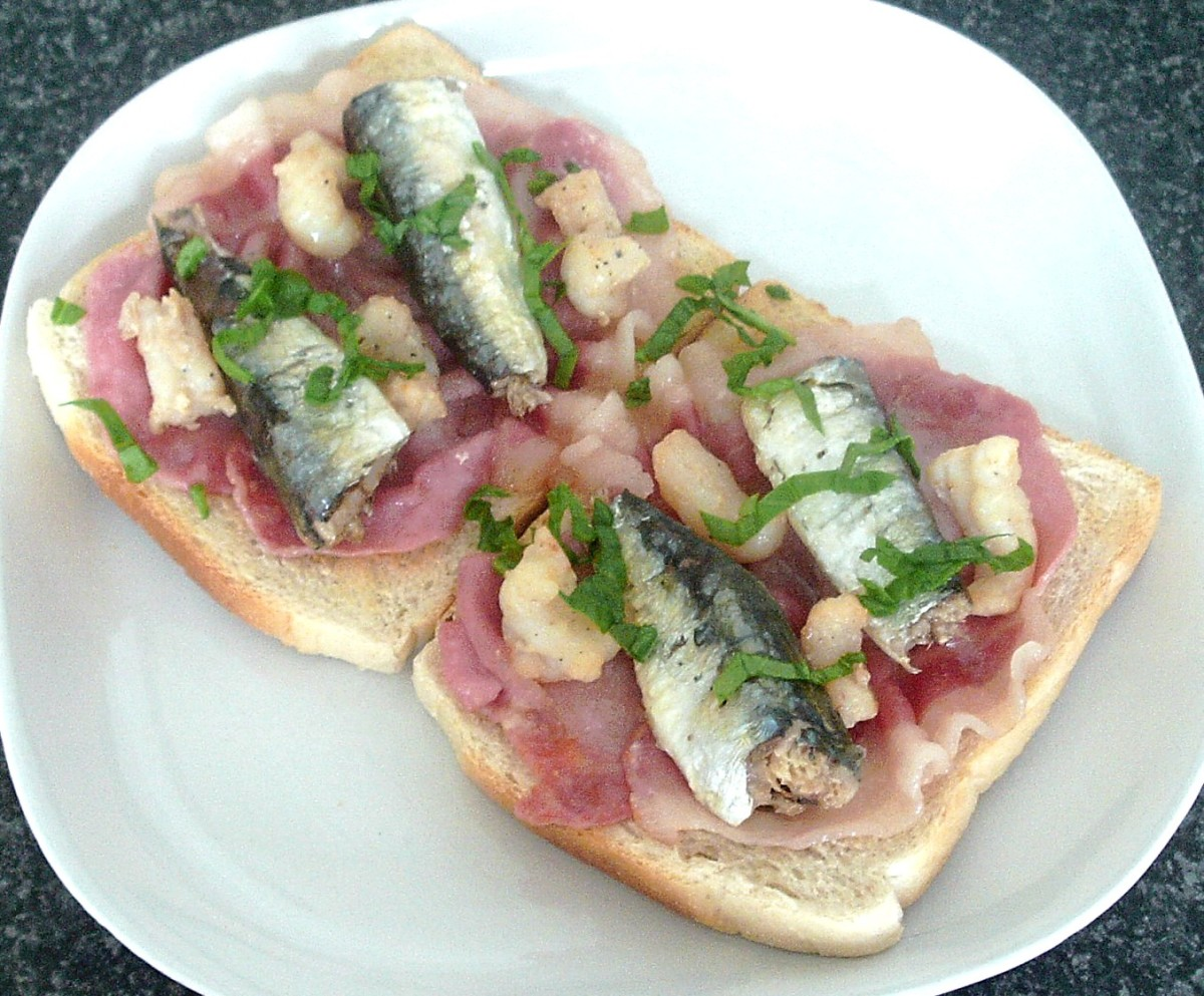 Bacon, sardines and scampi tails on toast
