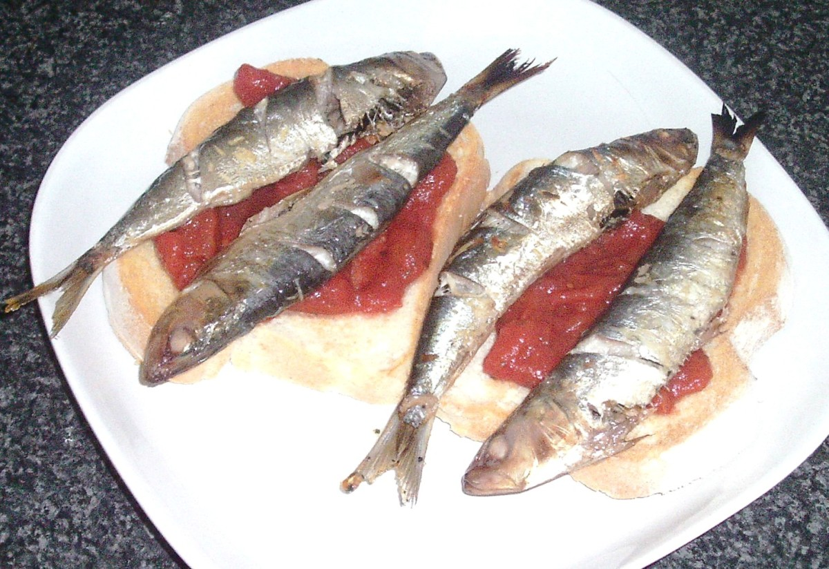 Grilled/broiled sardines and homemade tomato sauce on toast