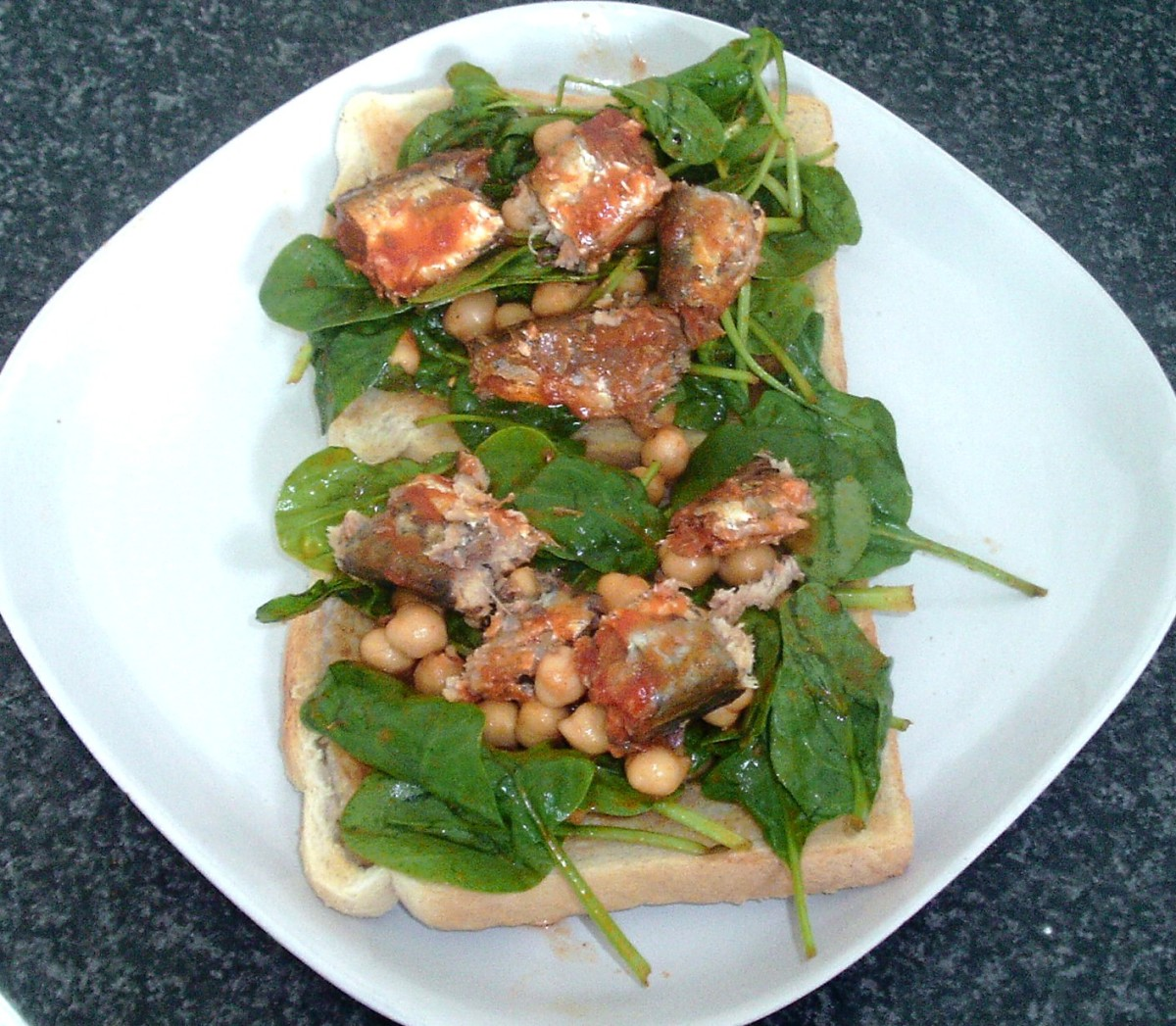 Sardines top spicy tomato chickpeas and spinach on toast
