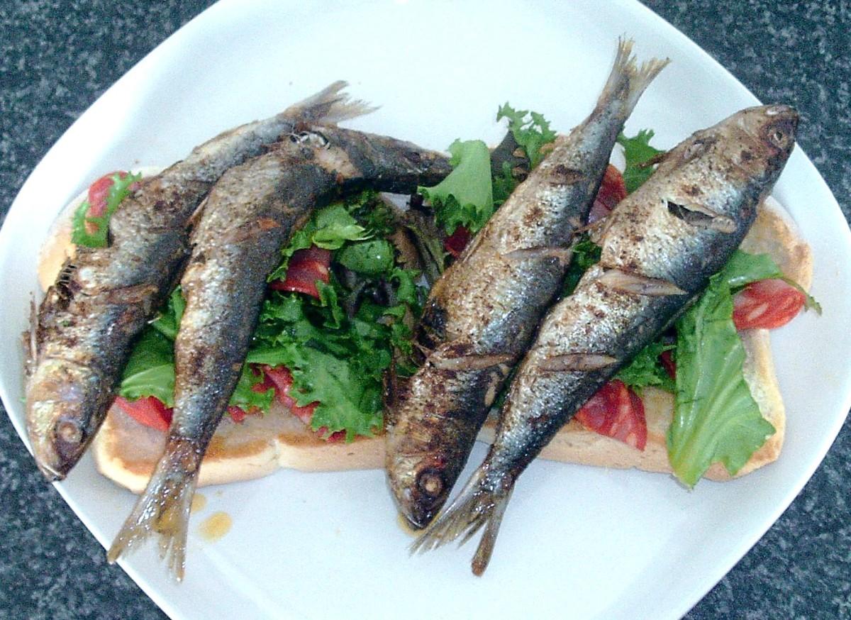 Pan fried paprika sardines and chorizo salad on toast