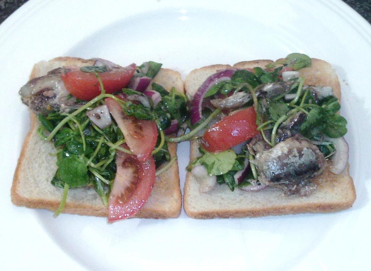 Sardines and watercress salad on toast