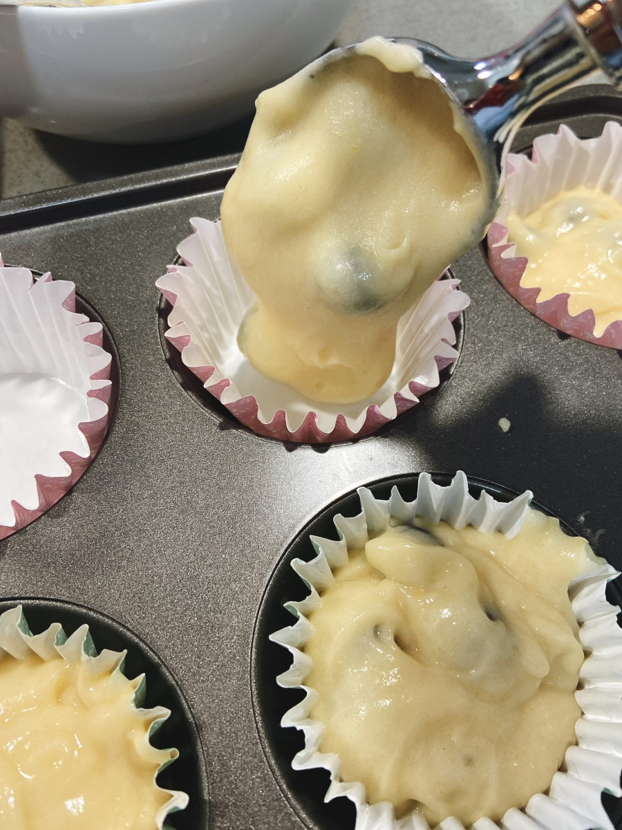 Use an ice-cream scoop to fill the muffins cups.