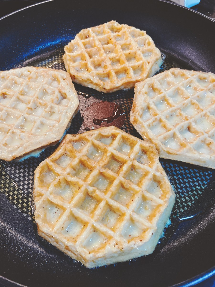 Put the coated waffle in the pan.