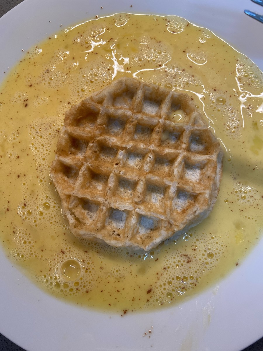 Take the first waffle and dip it in the batter thinly.