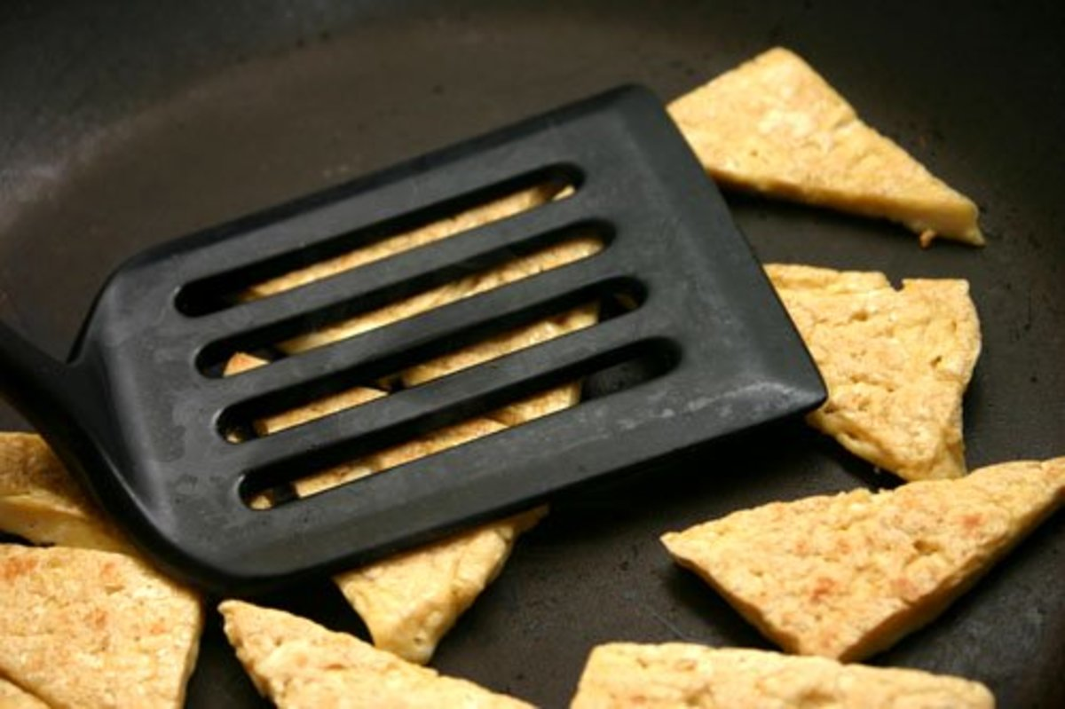 Press with a spatula to remove water.