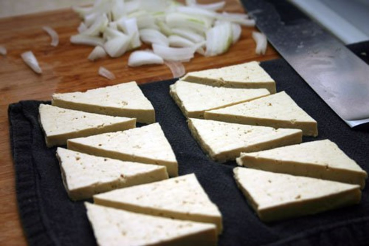 Tofu drained and cut into 1/2 inch thick triangles.