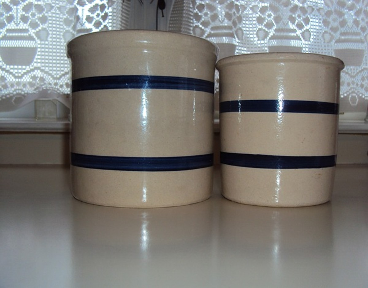A ceramic pot is good for use as a crock. A metal pot leaches metal molecules into the mix and produces an off flavor..