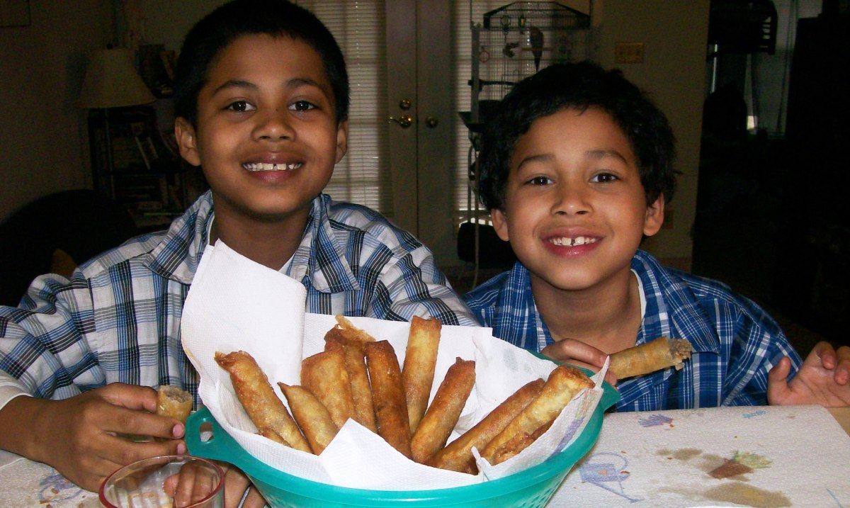 My sons enjoying a basket of their Nani's lumpia recipe.