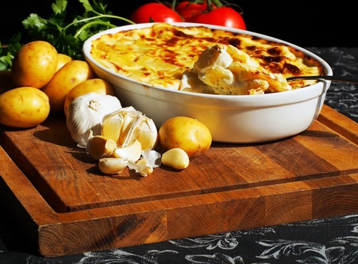 A creamy scalloped potatoe casserole with potatoes, milk, cheese and other flavorful ingredients.