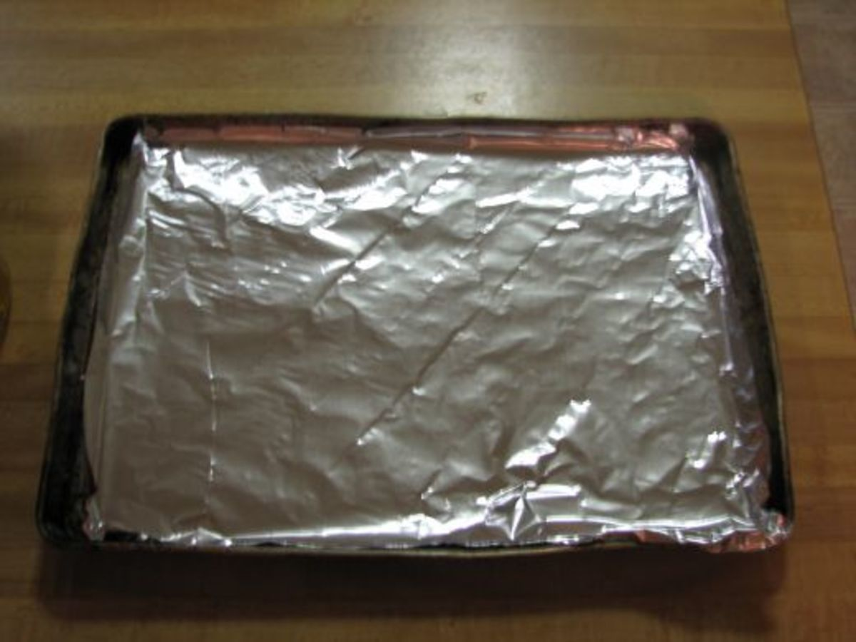 Cover the cookie sheet with a sheet of heavy duty tin foil