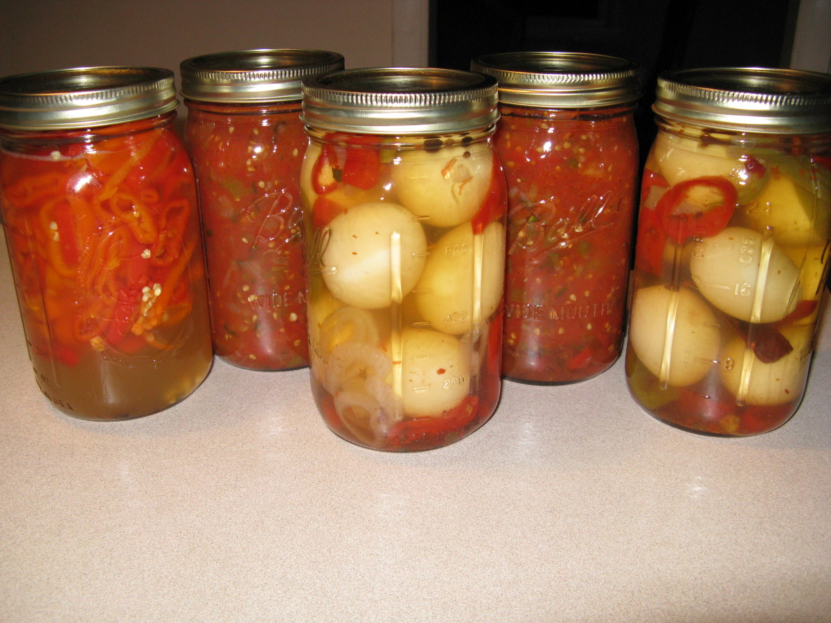 Pickled eggs with some salsa in the background