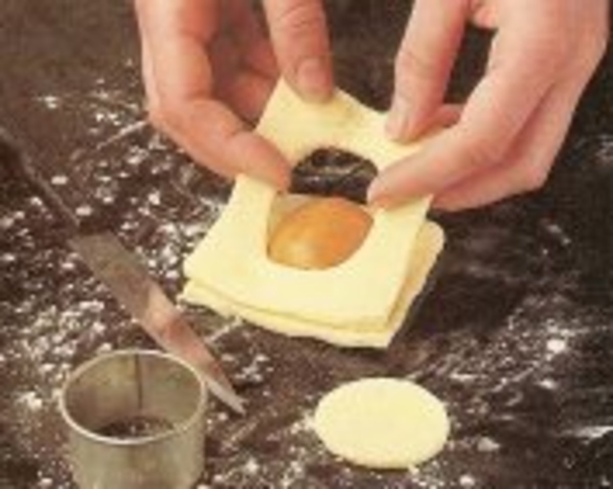 Place an apricot in the center of dough square.