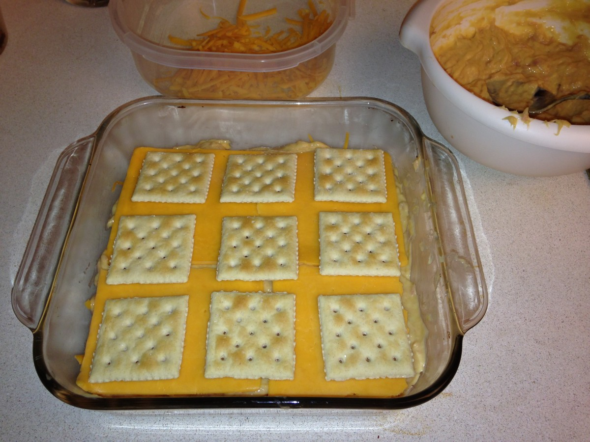 Third layer of crackers, with a heavier layer of cheese underneath.
