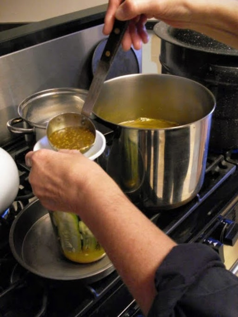 Ladle hot solution over cucumbers, leaving a 1/2-inch headspace. Wipe rim of jar with clean, damp cloth or paper towel.