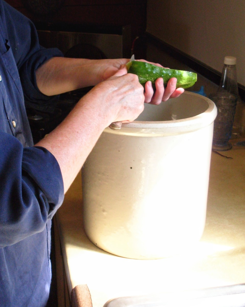 Slice cucumbers lengthwise into a suitably sized crock, or a large, non-reactive mixing bowl.