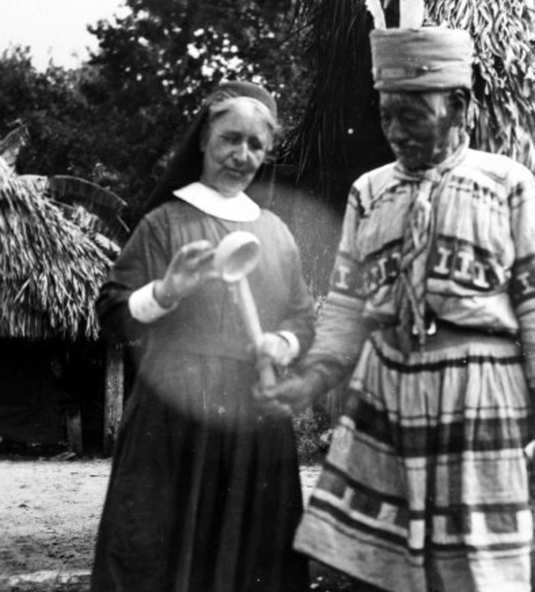 Deaconess Harriet Bedell with a cypress-wood  sofkee spoon, with Doctor Tiger  in a Seminole camp in 1936.