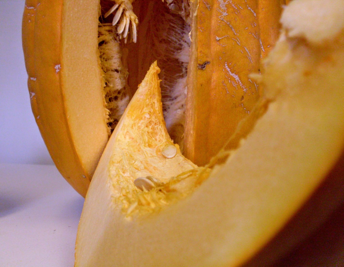 ...to cut neat wedges of golden pumpkin. Pause to admire the beautiful, golden cave all hung with roastable seeds.