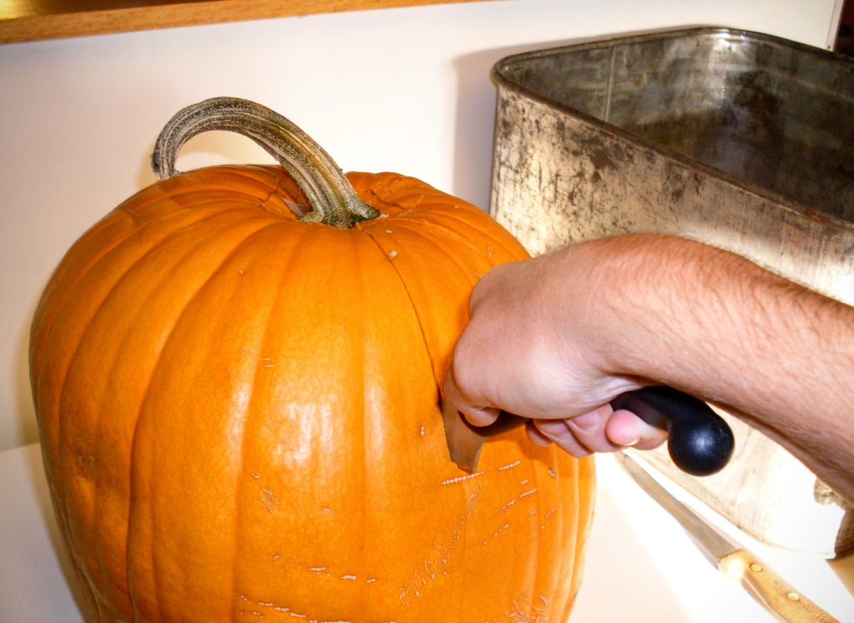 ...then switch to a serrated knife and cut to the bottom center of the pumpkin. Repeat at a different angle...