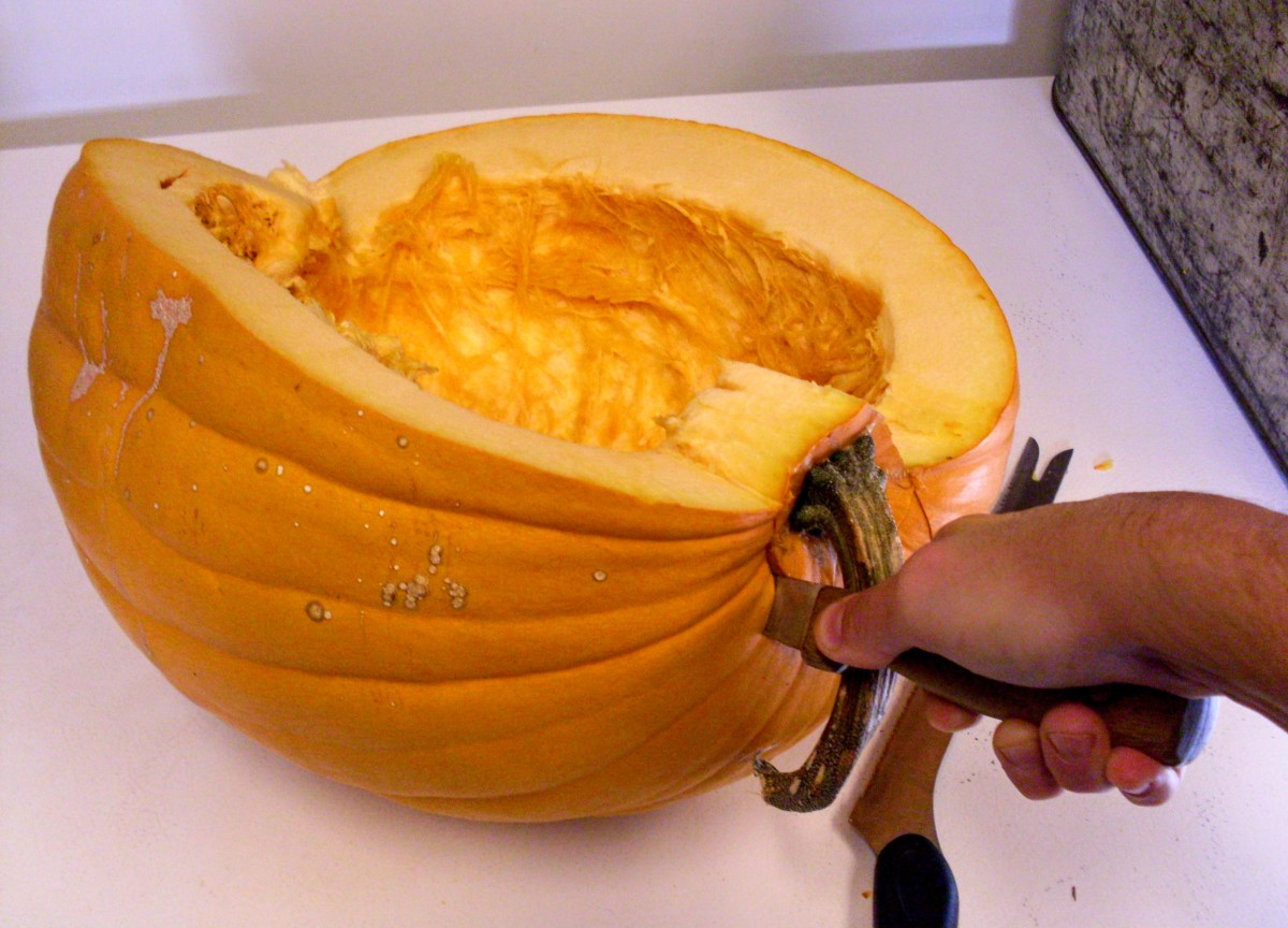 "The more wedges you cut, the harder it may be to hold your pumpkin still. Engage another pair of hands if necessary. Scrape seeds into a waiting bowl as you complete each slice, but don't bother yet with ""strings""."
