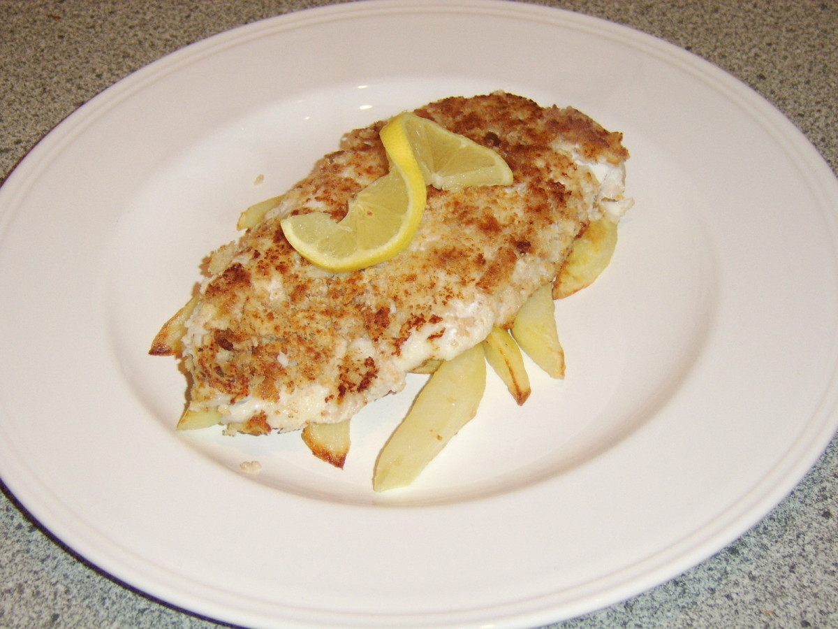 A Scottish fish supper features battered haddock and chips. This is a healthier version of the meal that uses breadcrumbs.