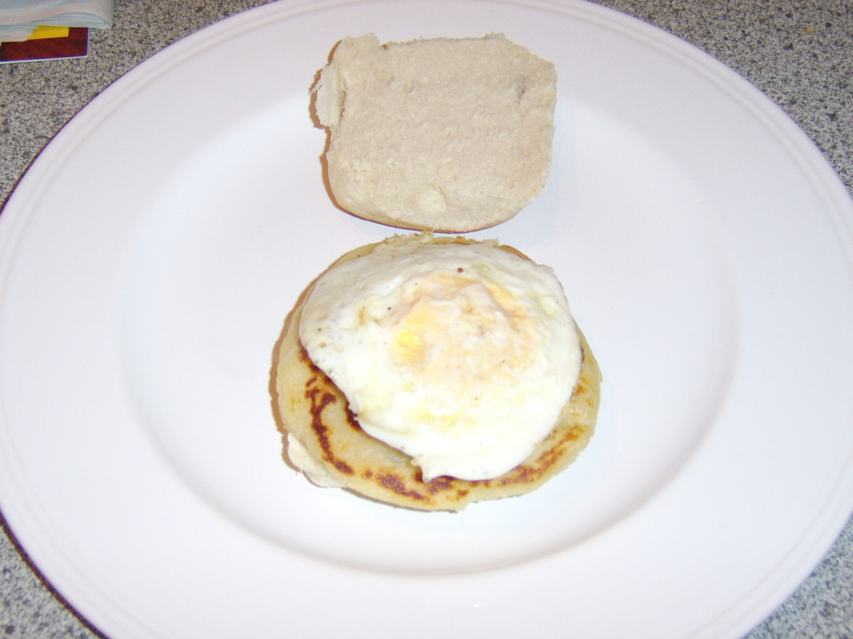A roll and sausage and tattie scone with a fried egg.